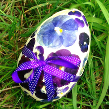 chocolate easter egg decorated with edible flowers